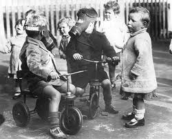 World War Two British children in gas masks.