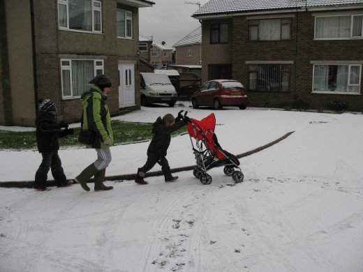 My mum, enjoying the snow with my boys, last year.