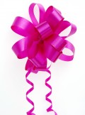 Multi-loop bow with curled ribbon in a monochromatic look.