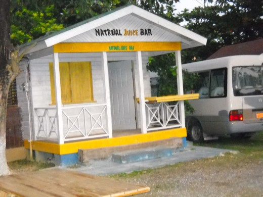 A local store in Negril, Jamaica   All the buildings except the resorts are small and colorful.