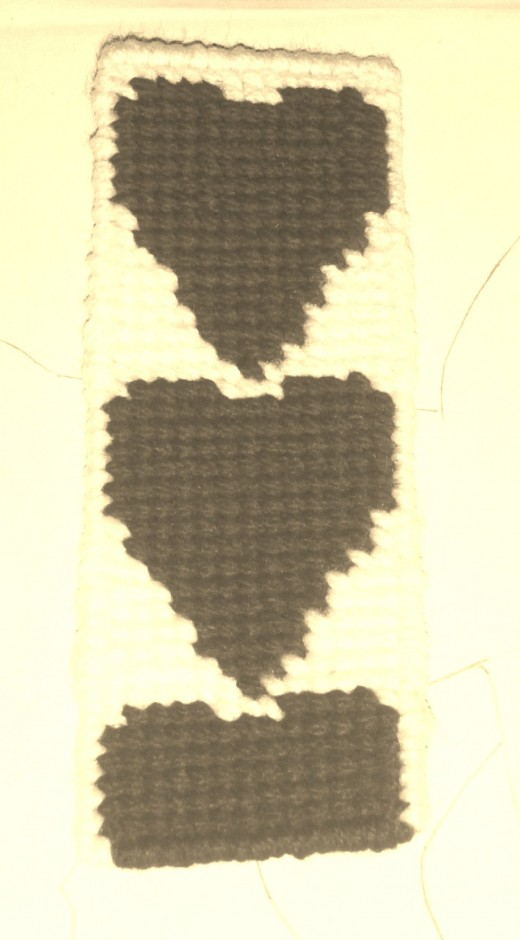 Here is a sepia photograph I took of a heart cross stitched bookmark I made.  The red heart has a very interesting look in sepia tones.