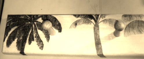 Here is another picture of the wood burning of palm trees in sepia tones.