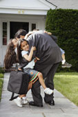 Dad hugging children, displaying affection and is loved.