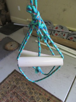 "Homemade suspension trainer with 1 1/2"" handles and foot 'straps.'"