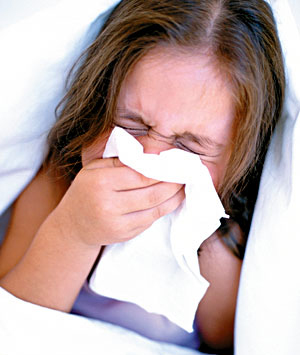 Sneezing into a tissue. Remember to throw away the tissue immediately and  wash your  hands.