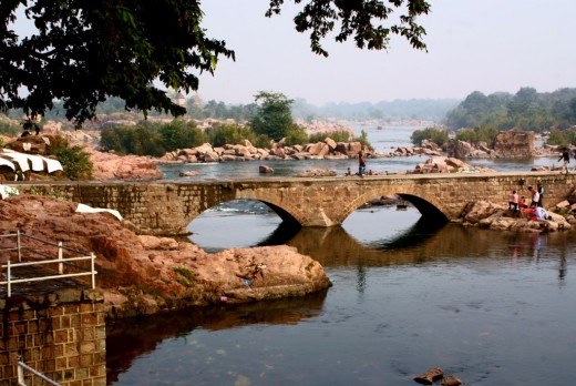 The ancient arched stone bridge on river Betwa