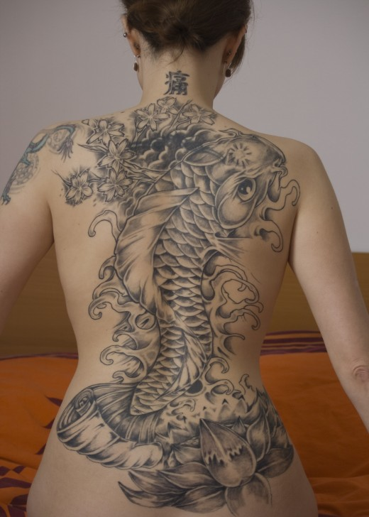 dragon waterfall tattoo. In the East dragons are