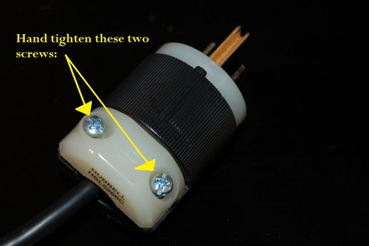 Now tighten up those top two screws so that the wire is secured to the new plug. Now you're almost done...