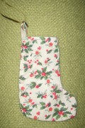 photo, picture of Christmas decoration made in  printed Christmas fabric,  Christmas holly stocking