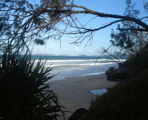 Looking south, beyond the distant headland -  Noosa.