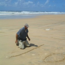 Our guide drawing a map in the sand so we don't get lost.