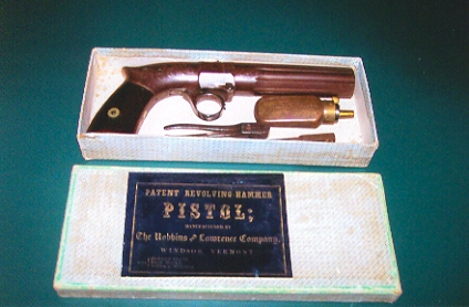 The standard pistol came with wooden grips and was sold in a cardboard box.