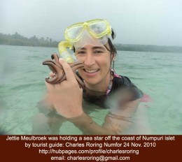 Jettie was holding a sea star while snorkeling in Numfor island