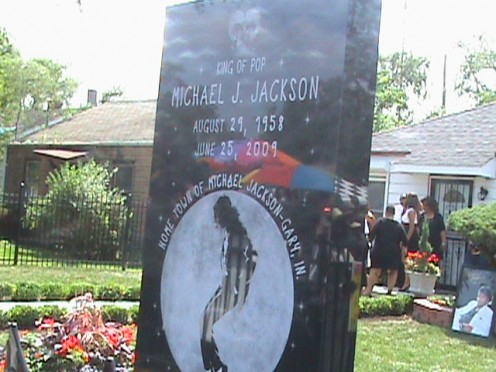 Granite Monument in front of Michael Jackson Childhood Home.  Dedicated by City of Gary 1 year after his death. Jackson relatives in background.
