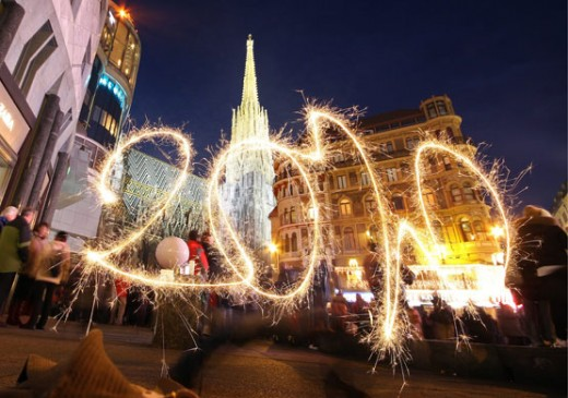 A young woman celebrates  New year's eve in Vienna,Austria with sparkles.