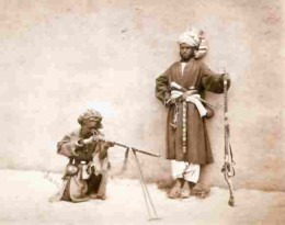 Frontier tribesmen demonstrate the 'jezail' to an early photographer