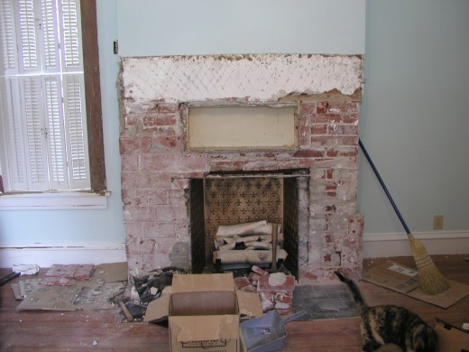 "The existing fireplace was damaged and covered with fake 'tiles,' and cheap 1/4"" painted plywood."