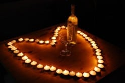 In setting the mood, would you prefer candle light, artificial light, or no light?