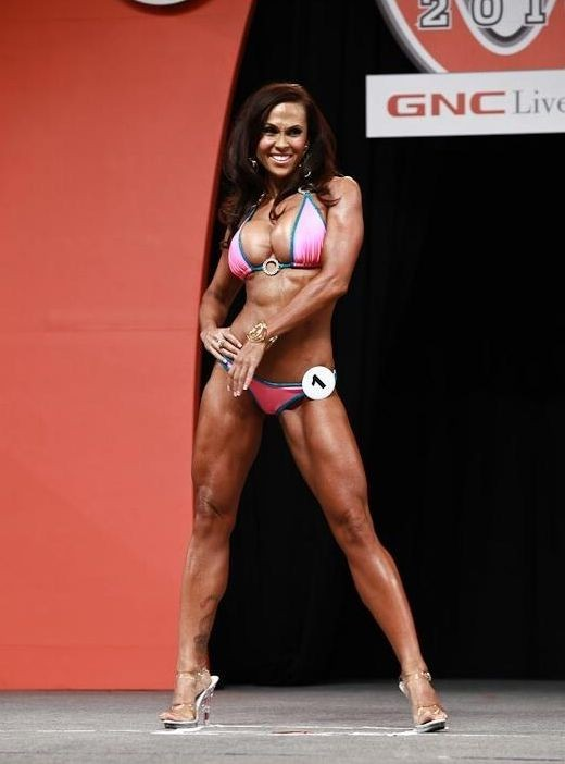 11 years after her debut, Dina competes at the 2010 IFBB Bikini Olympia