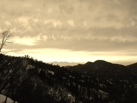 Brilliant sunset in the San Bernardino Mountains with snow that has not melted.