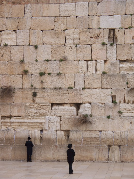 The faithful pray in the shadow of the Western Wall