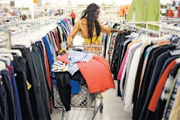 woman shopping for clothes at a thrift store