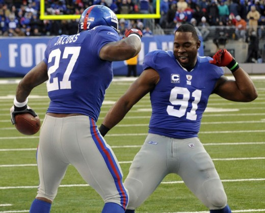 DE Justin Tuck celebrates with RB Brandon Jacobs' second touchdown against the Washington Redskins.