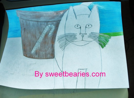 Now the golden color of the candy cane pot is colored in, and I am beginning to add the shading for the grass behind the Christmas cat.