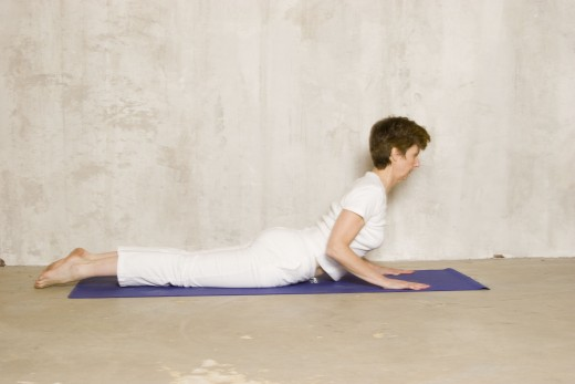 In gentle cobra, lift with your back not your arms.  Feel the bend between your shoulder blades more than in your lower back.  Reach forward and up with your heart.