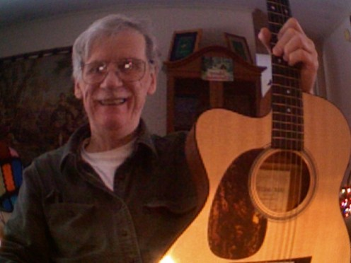 This is the guitar on which I played the Slide Blues CD. I have it tuned in an 'Open D' tuning. I go between this guitar and a Martin XC1T Ellipse for most of my acoustic tunes.