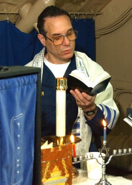 Jewish chaplain conducts services aboard the aircraft carrier USS Abraham Lincoln