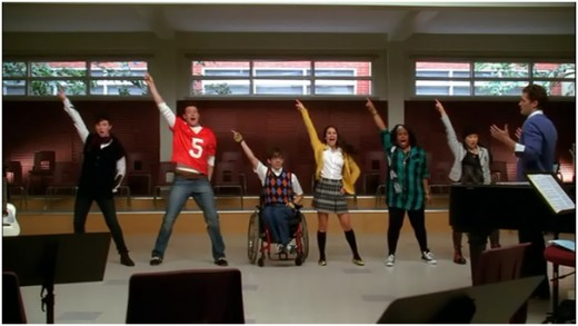 "New Directions singing ""Le Freak"" by Chic with little enthusiasm"