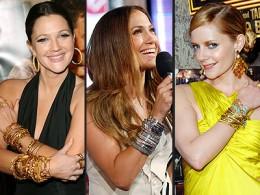 Three celebrities wearing bold bangles