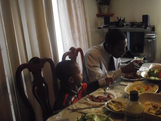 My grandson enjoying his grape juice