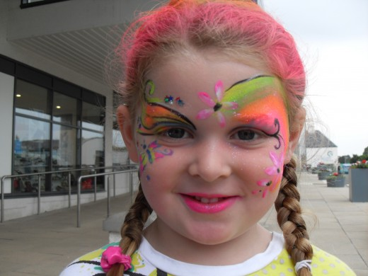 Add a few flowers to a face paint design