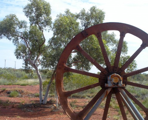 Still life with rusty wheel and gum tree. Tennant Creek