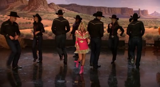 "April performing ""Last Name"" by Carrie Underwood with the Glee club for the invitationals"