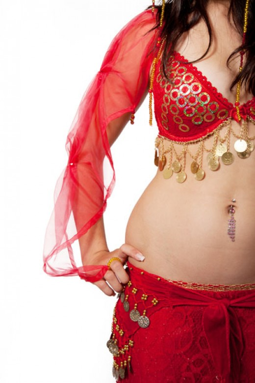 A belly dance workout strengthens the core, burns calories, and shapes the body into feminine curves.