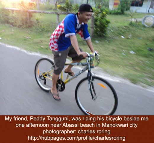 Riding Bicycle with My Friend Peddy Tangguni in Manokwari city