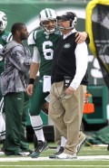 Jets Mark Sanchez puts his arm around coach Rex Ryan and LT in the backround during the first half of the Buffalo Bills vs. the New York Jets at the new Meadowlands Stadium. 1/2/11 John O'Boyle / The Star-Ledger