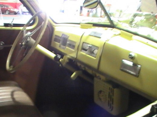 Classics and Chrome Car Show Loves Park Illinois photo of yellow Studebaker truck with yellow interior
