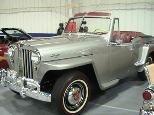 classic silver Jeepster with burgundy interior