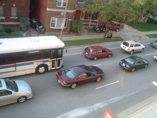 Four cars and a bus.