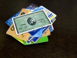 A stack of typical credit cards offering rewards