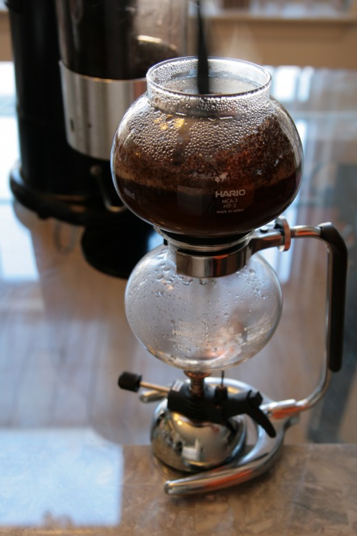 Give the coffee a quick stir to make sure all the ground coffee is fully immersed.