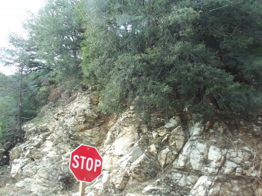 A stop sign near one of the turnouts on Highway 18.  If you pull into this turnout it is very spectacular with the view of the canyon above it.