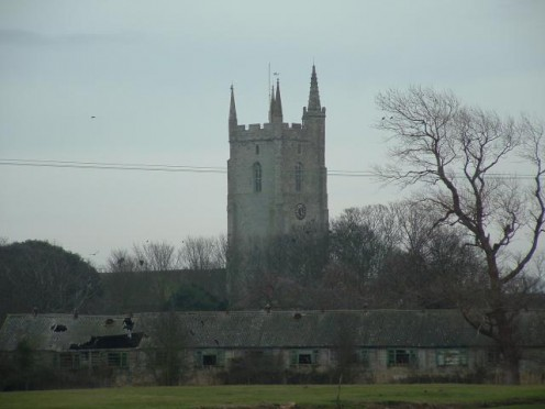 Lydd, Kent, seen with the Medieval tower of All Saints Church, known as 'The Cathedral of the Marsh'