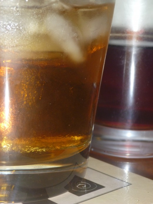Rusty nail and coke You can see the ice and the different tones in drambui and scotch