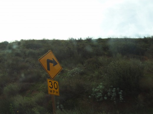 Signs reminding people only drive thirty miles per hour around the curves on Highway 18.