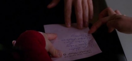 Rachel handing Will a list of the Glee members who were bluffing their way through rehearsal.
